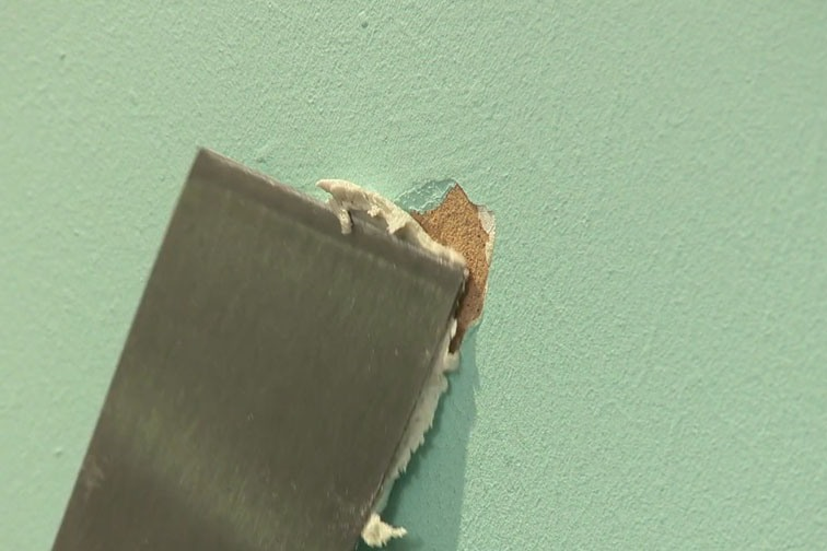To fix the hole in your wall apply some filler with a filling knife.