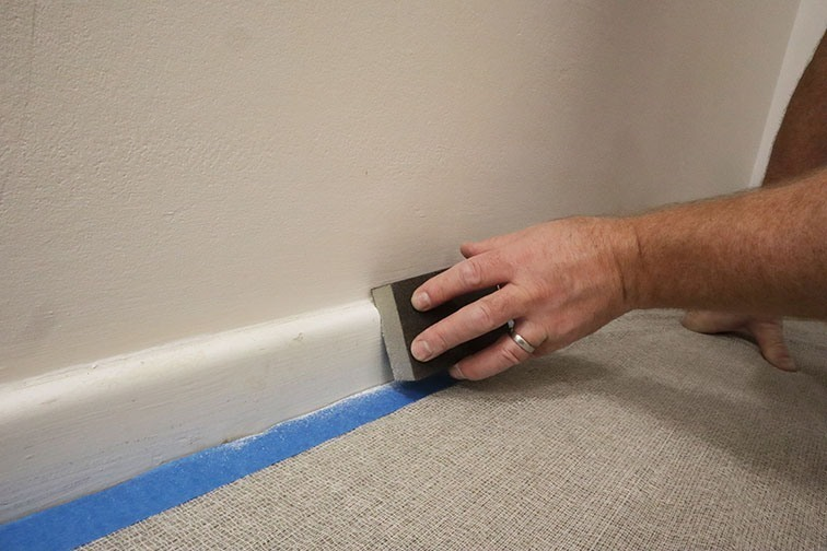 To get a perfect finish with gloss paint start by sanding the surface.