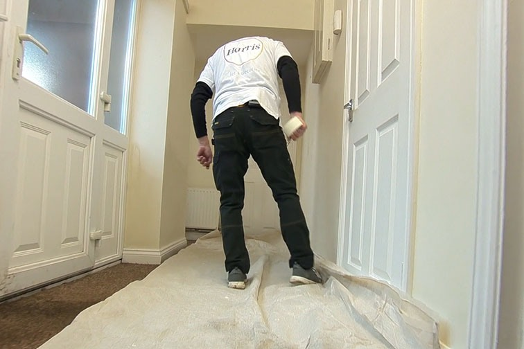 Lay a dust sheet to protect the floor before you start to paint your skirting boards.