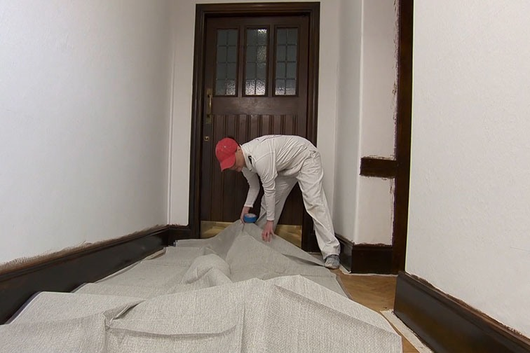 Before hanging wallpaper lay a dust sheet to protect the floor.