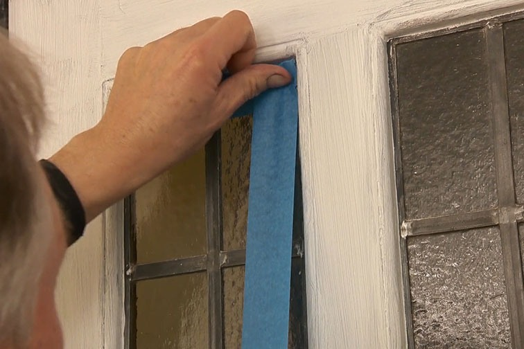 Use masking tape to protect any parts of the door you do not want to paint.