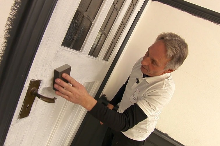Before you paint the door, use some sandpaper and sand until smooth.