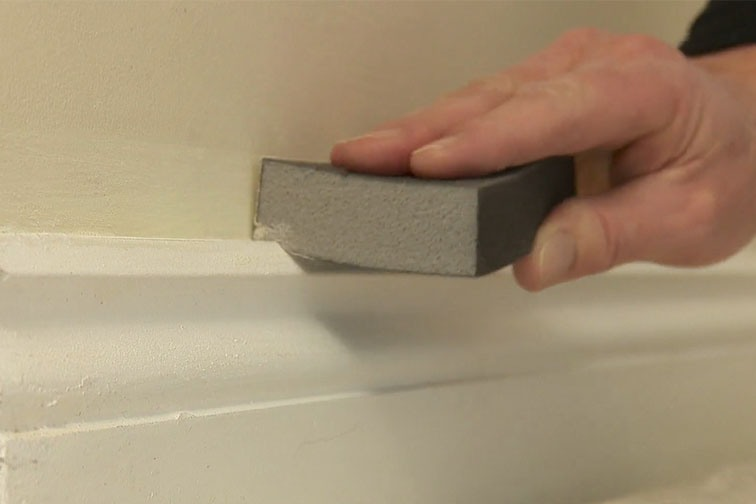 Before you start painting your skirting board, sand it until it's smooth.