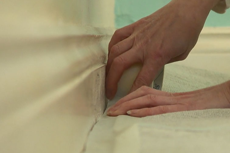 Use masking tape to keep the dust sheet in place.